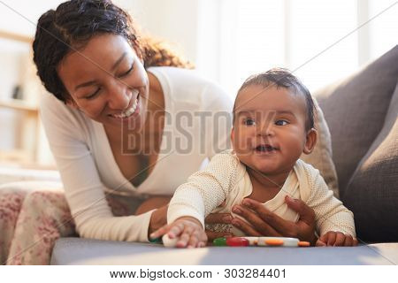 Positive Loving Young Black Mother Spending Beautiful Time With Her Baby On Maternity Leave At Home