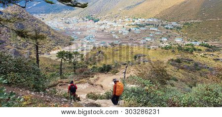 Two Of Trekker Walk To Village At Himalayas Trail On The Way To Everest Base Camp, Khumbu Valley, Sa