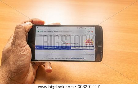 Maski, India 27,may 2019 :concept Of Applying Aadhar Card Online Using Mobile Phone.