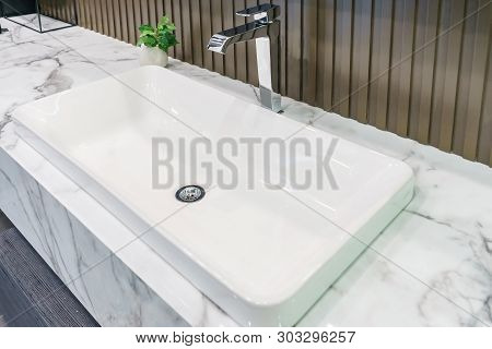 Interior Of Bathroom With Sink Basin Faucet And Mirror. Modern Design Of Bathroom