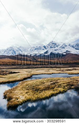 Reflection Of Mountains And Clouds In Clear Surface Of Lake. Golden Autumn In Mountains.