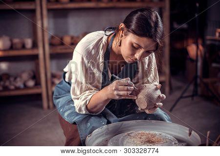 Charming Ceramist Girl Is Working On Pottery Wheel. Handmade.