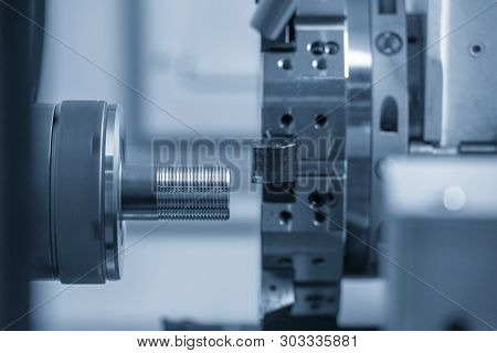 The Cnc Lathe Machine Cutting The Thread    At The Metal Tube. The Hi-technology  Parts Manufacturin