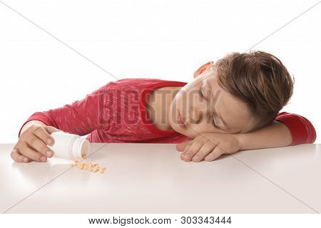 Little child with pills on white background. Danger of medicament intoxication poster