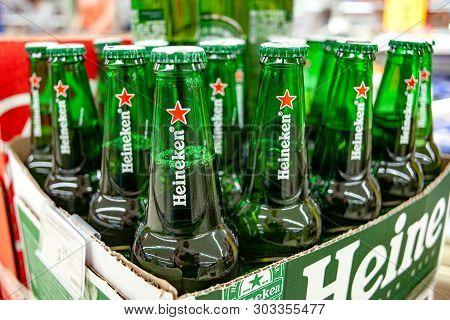 Minsk, Belarus - May 22, 2019: The Heineken Lager Beer Is A Dutch Blonde Beer. Glass Beer Bottles He