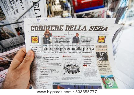 Strasbourg, France - May 27, 2019: Wide Image Man Holding Buying Newspaper Corriere Della Sera Front