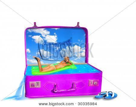Young woman in bikini on air bed in a suitcase swimming pool- Travel concept