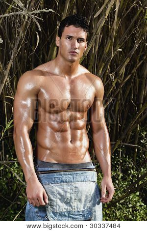 Male Model With Muscles On The Countryside