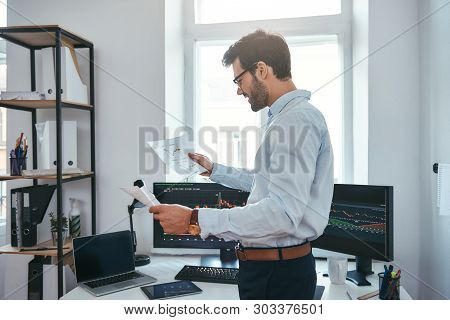 Good News Happy Young Businessman Or Trader In Eyeglasses And Formal Wear Looking At Trading Charts