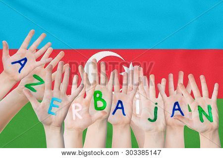 Inscription Azerbaijan On The Children's Hands Against The Background Of A Waving Flag Of The Azerba
