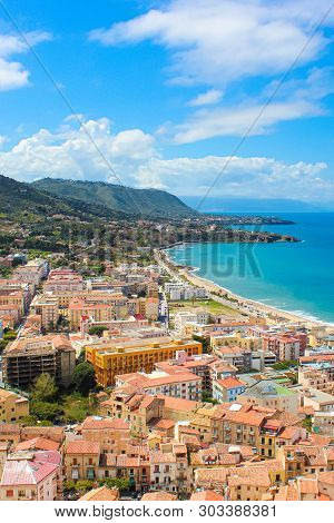 Stunning View Of Coastal City Cefalu In Sicily, Italy Captured On A Vertical Picture. The City On Ty