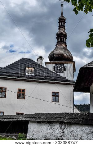 Old Church With Clock And Spire Tower