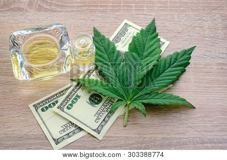 Earnings From The Sale Of Cannabis Medicament Products. Cannabis Leaf, Hemp Oil And Money.