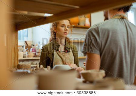 Long-haired Ginger Girl Talking To Her Dark-haired Partner