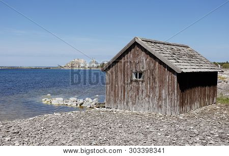Old Fishing Shed At The Shore In The Swedish Province Of Gotland
