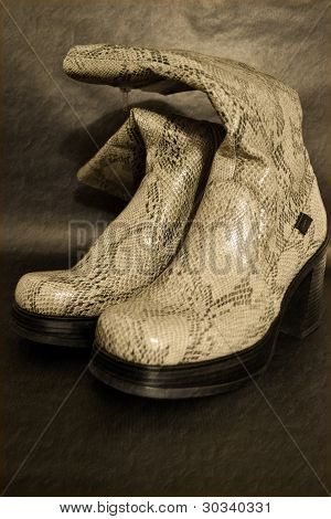 Old synthetic leather boots