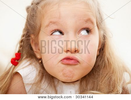 Grimacing child. Nescience little girl. I do not know