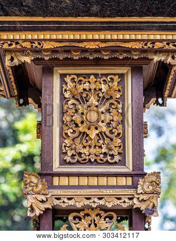 Dusun Ambengan, Bali, Indonesia - February 25, 2019: Clan Compound. Closeup Of Golden Decoration Squ