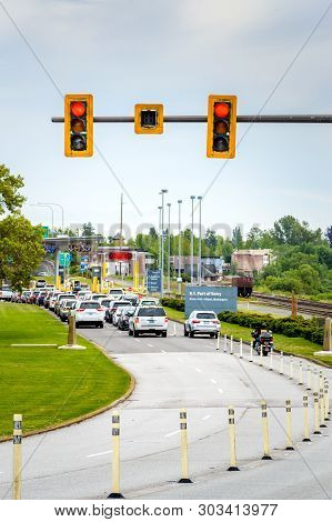 May 26, 2019 - Surrey, Bc: Red Traffic Light Above Lanes Approaching Usa Border At Peace Arch Park.