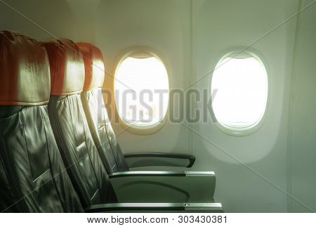 Empty Airplane Seat Economy Class In The Cabin Of The Commercial Airline. Cheap Plane Seat With Wind