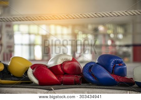 Leather Mitt Glove Placed On Canvas Of Ring In Camp Of Training Boxer.equipments For Protection Duri