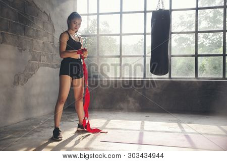 Boxing Woman Prepare To Trianing Session And Kickboxing,workout At Thai Boxing Gym.fit Female Exerci