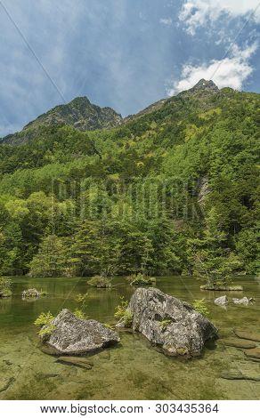 Idyllic Landscape Of Myojin Pond At Hotaka Rear Shrine In Kamikochi, Nagano, Japan