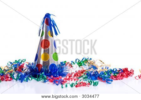 A brightly colored birthday hat and streamers on a white background with copy space poster
