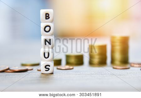 Yearly Bonus Concept / Words Of Bonus And Stack Coins On Background For Encouragement Morale On The