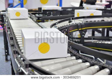 Cardboard Boxes On Conveyor Belt.parcels Transportation System, Concept