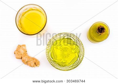 Cure to dandruff isolated on white i.e. Castor oil well mixed with ginger juice in a glass bowl along with entire raw ingredients. poster