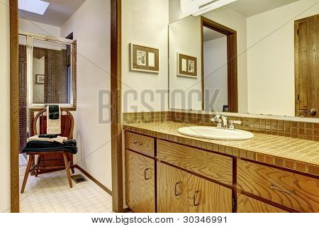 Outdated Brown Simple Bathroom With One Sink.