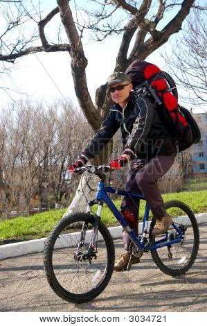 Man on bicycle travels on city. Island Sakhalin city Kholmsk. poster