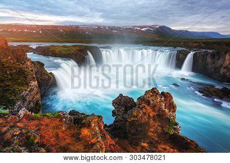 Incredible landscape with colorful sunrise on Godafoss waterfall on Skjalfandafljot river, Iceland