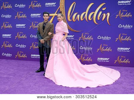 Mena Massoud and Naomi Scott at the Los Angeles premiere of 'Aladdin' held at the El Capitan Theatre in Hollywood, USA on May 21, 2019.