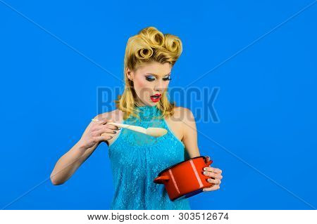 Housewife Cooking In Kitchen. Retro Style. Cooking Utensils. Cooking Woman In Kitchen With Saucepan,