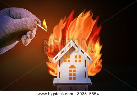 Hand In Glove With A Burning Match Sets Fire To The House Model Of Matches, Risk, Property Insurance