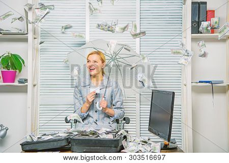 Woman Business Lady Or Accountant Under Umbrella. Financial Success. Accountant With Pile Money Hide