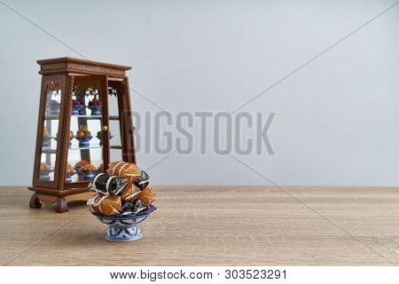 Stack Thai Caramel On Pedestal Tray With Blur Cabinet Dessert
