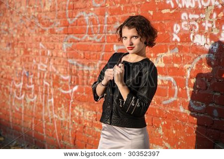 Young Girl Near The Wall