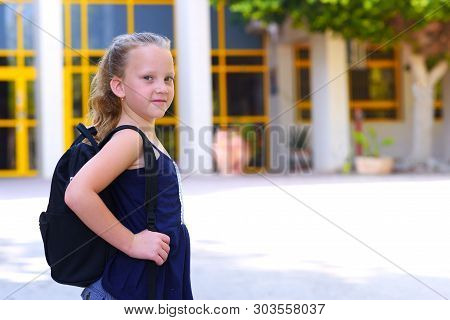 Portrair Happy Smiling Kid Back To School. Child Little Freckles Girl With Bag Go To Elementary Scho