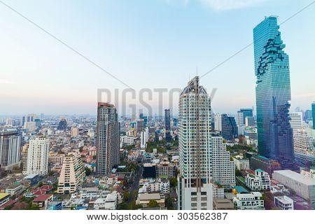 Modern office buillding and condominium sunset sky, Bangkok Thailand poster