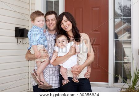 Portrait of a young family with mother, father, son and daugther