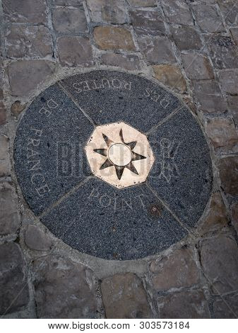 A Kilometer Point In France (located On The Square In Front Of The Notre Dame Cathedral In Paris) Fr