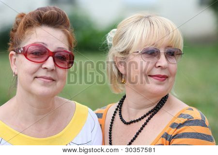 two mature women in park