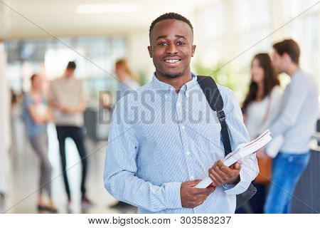 Young african student in college or university studies