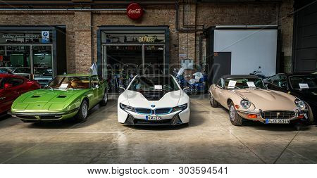 Berlin - May 11, 2019: Sports Cars Maserati Indy (left), Bmw I8 (center), Jaguar E-type (right). 32t