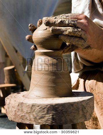 Potter's Hands Works A Potter's Wheel