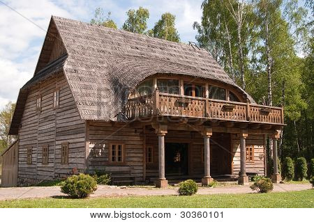 Rural House With Traditional Wooden Roof
