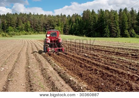 Tractor At Work On A Field